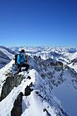 Female back-country skier ascending to Zwerchwand, Zillertal, Zillertal Alps, Tyrol, Austria
