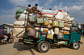 Overloaded Truck with passengers on the top at a market south of Inle Lake, Shan State, Myanmar, Burma, Asia