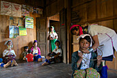 Longneck Karen women wearing typical necklaces, a thirteen year old school girl getting a necklace the first time on er own will, Padaung women near Loikaw, Kayah State, Karenni State, Myanmar, Burma, Asia