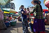 Burmese women selling fruits in the city center, Yangon, Rangoon, capital of Myanmar, Burma