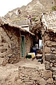 Boy playing guitar on a rooftop in a mountain village, Praia, Santiago, Cape Verde