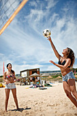 Women playing beach volleyball near Water Sports Centre, Martinhal Beach, Sagres, Algarve, Portugal, southernmost region of mainland Europe