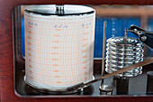 Barograph aboard expedition cruise ship MS Hanseatic (Hapag-Lloyd Cruises) indicates extreme low pressure as vessel approaches storm, Ross Sea, Antarctica