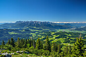 View over alpine meadows and Inn Valley, Kaiser Mountain Range and Zillertal Alps in background, Spitzstein, Chiemgau Alps, Tyrol, Austria