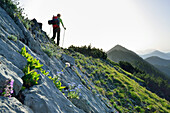 Woman hiking along a ridge, Blauberge, Bavarian Prealps, Upper Bavaria, Bavaria, Germany