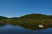Two fishermen sitting in a rowing boat on Lake Edersee in Kellerwald-Edersee National Park, Herzhausen, Lake Edersee, Hesse, Germany, Europe
