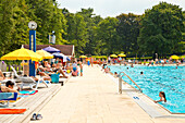 People enjoying a sunny afternoon at the outdoor swimming pool Heloponte, Bad Wildungen, Hesse, Germany, Europe
