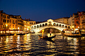 Silhouette of gondola on the Grand Canal with Rialto bridge at dusk, Venice, Veneto, Italy, Europe