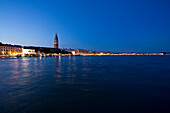Campanile and Piazza San Marco at night taken from the waterside, Venice, Italy, Europe