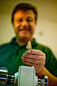 Man holding a turned tree, Murau, Styria, Austria