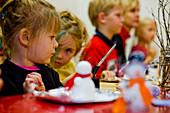 Children doing christmas crafts, Muraum, Styria, Austria