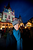 Young woman at a christmas market, Graz, Styria, Austria