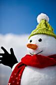 Snowman wearing cap and scarf, Kreischberg, Murau, Styria, Austria