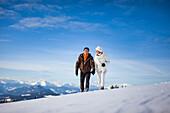 Couple walking through snow, Zirbitzkogel, Muehlen, Styria, Austria
