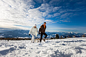 Couple pulling a sledge through snow, Zirbitzkogel, Muehlen, Styria, Austria