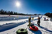 Young women with snowtubes, Kreischberg, Murau, Styria, Austria