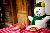 Snowman eating pumpkin cream soup, Styria, Austria