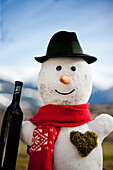 Snowman with a bottle of wine, Styria, Austria