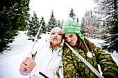 Two young women with fake beards and swords of icicles