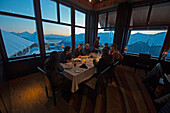 Group of people having dinner in a restaurant, Alyeska Resort, Girdwood, Alaska, USA