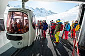Skiers at a ski lift station, Gressoney, Aosta Valley, Italy