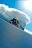 Skier downhill skiing in deep snow, Puma Lodge, Araucania Region, Chile