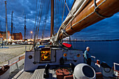 Sailing ship at landing pier in harbor in the evening, Stralsund, Mecklenburg-Western Pomerania, Germany