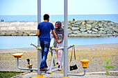 Couple at the waterfront in Trabzon, Black Sea, East Turkey, Turkey