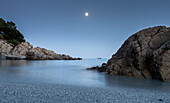A full moon night, the pleasant blue hues that give a feeling of peace, this beach of Cala Liberotto, Sardinia