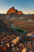 Sunset in mountain's landscape, with Rocca la Meja peak, and an alpine's lake, Maira valley, Piedmont