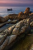 Fisherman along the coast of the Ligurian Sea