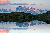 The Black lake near at Cornisello town with Brenta mountains  reflected in the water