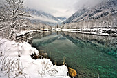 An alpine lake in wintertime, in the valley, Masino valley, Lombardy