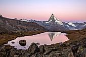 The big Matterhorn's reflection in the Lake Stallisee at sunrise, Zermatt valley, Valais-Wallis Canton, Switzerland