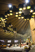 Ceiling lights illuminate the altar in the interior of the modern Basilica of the Virgen de Guadalupe in Mexico City, Mexico on June 11, 2008. Built on Tepeyac hill, where it is said the Virgin appeared to Juan Diego Cuauhtlatoatzin in 1531, the new Basil