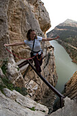 Senja Palonen on the Walkway, also known as the Camino del Rey the King's Path,. Built around 1905 to enable access and inspections to the workings in the Gorge and named after the visit of King Alfonso VIII in around 1921. El Chorro, Andalucia, Spain