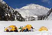 TALKEETNA, ALASKA - JUNE 7, 2008: National Park Search & Rescue tents at 7200 foot basecamp on Kahiltna Glacier. In the background is Mt. McKinley.