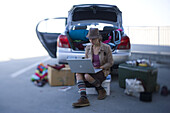 Day 300 and counting. While seated amidst her belongings at the trunk of her car, aspiring actress Jodi Elliott works on her computer before an audition. Elliott has spent the last 10 months living out of her car. She house sits, couch surfs and has manag