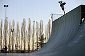 Skateboarder Balancing Upside Down at Skate Park