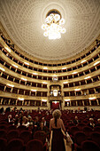 The world-famous La Scala opera house in Milan fills with visitors who came to watch an opera.