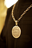 A medallion on the uniform of an usher at the world famous La Scala opera house in Milan, Italy.