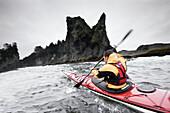 Todd Van Raden braves a 10 foot swell as he sea kayaks around the sea stacks of James Island, Washington coast line, USA, 6 October 2008.