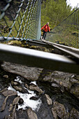 Paul Romer, on a suspension bridge while hiking the Aurland Valley from Osterbo to Vassbygdi in Norway.