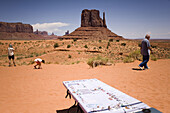 Tourists pass tables of Navajo crafts at Monument Valley Navajo Tribal Park in southern Utah. The park, operated by the tribe, was once a popular set for western films of the 1930s through 60s. It is immensely popular among European tourists.