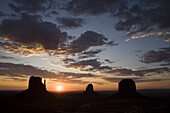 The sun rises over the most photographed view at Monument Valley Navajo Tribal Park in southern Utah. The park, operated by the tribe, was once a popular set for western films of the 1930s through 60s. It is immensely popular among European tourists.