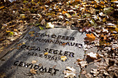 A plaque dedicated to the oldest known victim of the wall, an eighty year old woman who jumped out of the window of her Bernauer Strasse apartment to reach West Berlin.  Berlin, October 2008