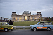 Trabi Safari at the Reichstag parliament building  A popular tourist attraction offers Berlin visitors the chance to drive original East German Trabant cars, one of two car models built in the GDR.  Berlin, October 2008