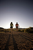 Rachel Elliott and Justine Ritsko running along the Historic Railroad Trail in the Lake Mead National Recreation Area.