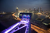 'The Singapore Flyer, a 42 story high observation wheel, was built to give tourists a 360 degree view of Singapore during a 30 minute ''flight'' in the safety and comfort of individual air conditioned cabins which each weight 16 tons and can hold up to 28