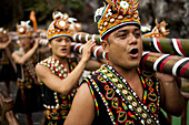 Aboriginal dancers sing as they enter a performance at Formosan Aboriginal Village, Taiwan, October 21, 2010.  Established to preserve the culture, traditions and history of Taiwan's native aboriginal people, the park is a popular spot for visitors hoping